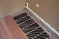 Укладка ламината на электрический теплый пол